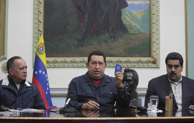 Venezuelan President Hugo Chavez speaks next to Vice President Nicolas Maduro and national assembly president Cabello during a national broadcast at Miraflores Palace in Caracas