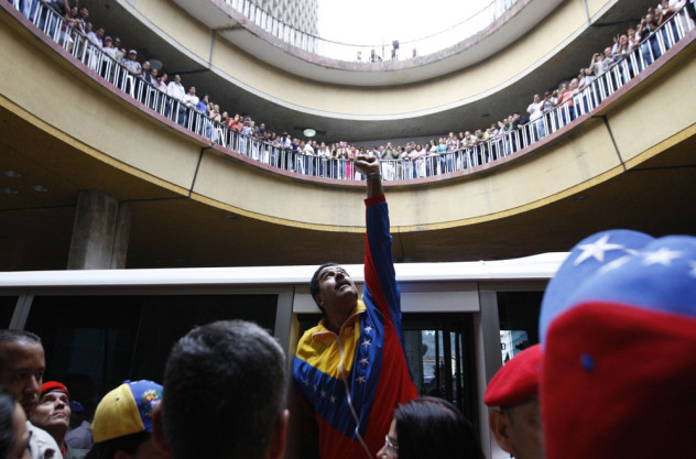 Venezuela's acting President Maduro gestures to supporters after he registered as a candidate for president in the April 14 election outside the national election board in Caracas