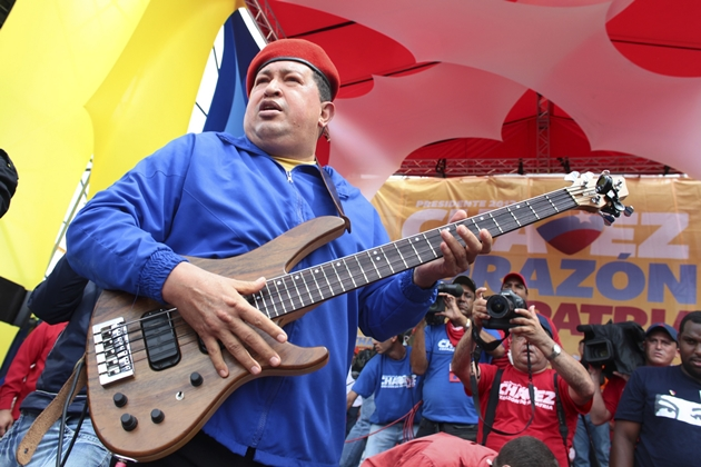 Venezuela's President Chavez plays guitar during an election rally in Valencia