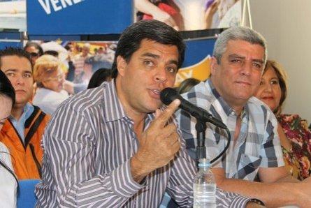 Oscar López junto a Rafael Marquina