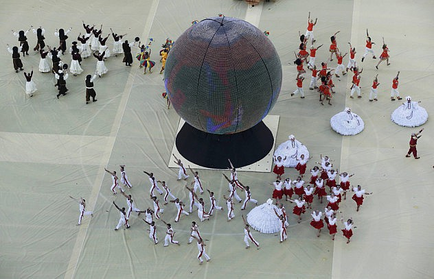 Performers take part in the 2014 World Cup opening ceremony at the Corinthians arena in Sao Paulo