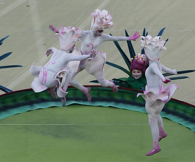 Performers jump on a trampolin during the 2014 World Cup opening ceremony in Sao Paulo