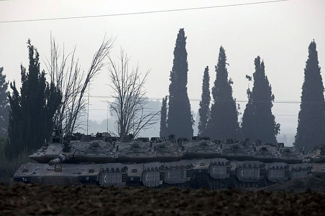 Israeli army tanks are seen outside the southern Gaza Strip