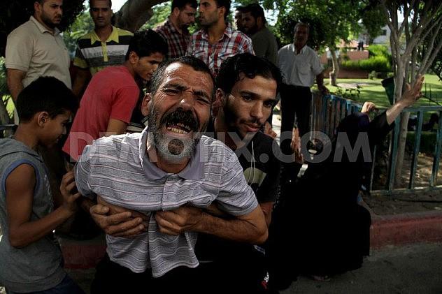 1405532039-palestine-mourns-death-of-4-children-killed-in-israeli-attack-on-beach_5279443