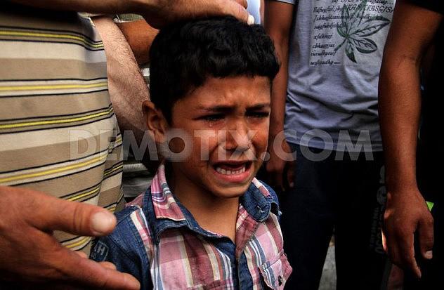 1405532046-palestine-mourns-death-of-4-children-killed-in-israeli-attack-on-beach_5279453