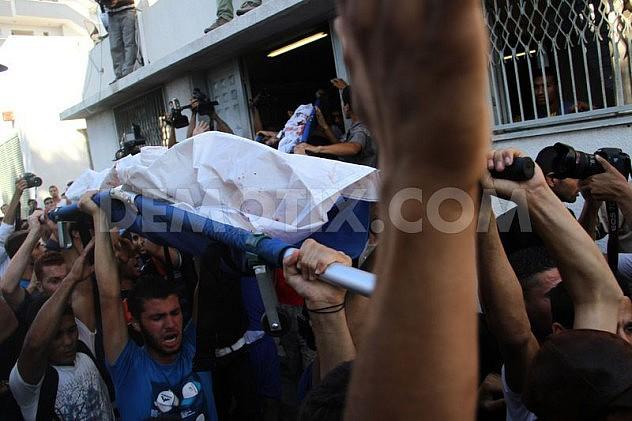 1405532049-palestine-mourns-death-of-4-children-killed-in-israeli-attack-on-beach_5279468