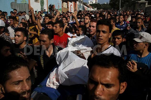 1405532051-palestine-mourns-death-of-4-children-killed-in-israeli-attack-on-beach_5279473