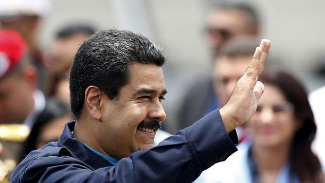 Venezuela's President Maduro waves after his arrival in Panama City