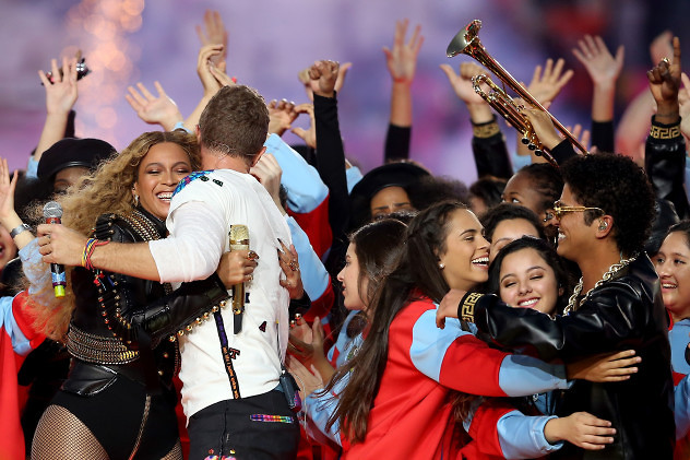SANTA CLARA, CA - FEBRUARY 07: (L-R) Beyonce hugs Chris Martin of Coldplay while Bruno Mars hugs fans following the Pepsi Super Bowl 50 Halftime Show at Levi's Stadium on February 7, 2016 in Santa Clara, California. (Photo by Streeter Lecka/Getty Images)