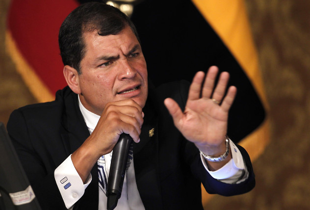 Ecuador's President Rafael Correa speaks during a meeting with the foreign press corps at government palace in Quito, Ecuador, Wednesday, Feb. 20, 2013. Correa talked about Sunday's election results in which he secured a landslide second re-election and also announced that he plans to visit the ailing Venezuelan President Hugo Chavez. (AP Photo/Dolores Ochoa)