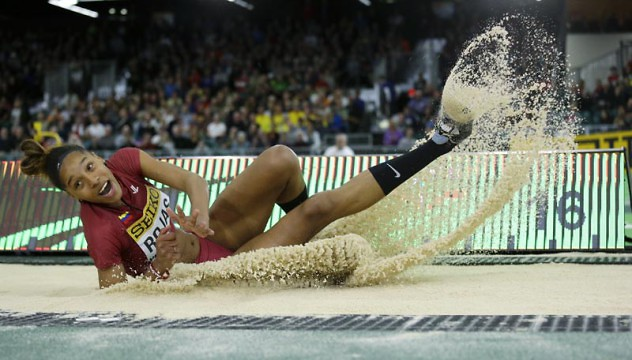 Venezuela's Yulimar Rojas lands in the sand after a jump in the women's triple jump final during the World Indoor Athletics Championships, Saturday, March 19, 2016, in Portland, Ore. (AP Photo/Elaine Thompson)