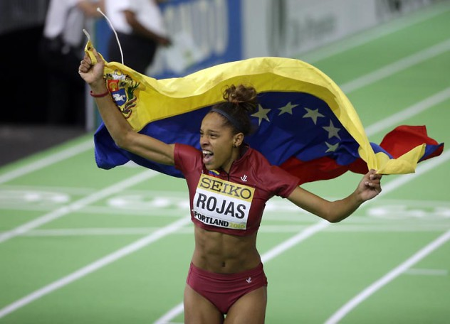 Venezuela's Yulimar Rojas celebrates with a flag after she won the women's triple jump final during the World Indoor Athletics Championships, Saturday, March 19, 2016, in Portland, Ore. (AP Photo/Rick Bowmer)