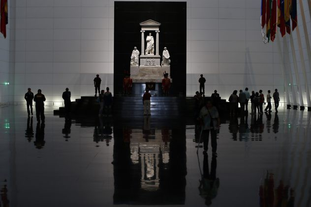 Visitors walk inside the mausoleum of Venezuelan national hero Simon Bolivar in Caracas May 21, 2013. After years of construction, the new mausoleum to the South America's independence hero was inaugurated this week. REUTERS/Jorge Silva (VENEZUELA - Tags: SOCIETY)