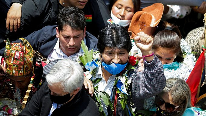 Morales raises his fist upon his return to Bolivia, in the city of Villazón, November 9, 2020. Reuters